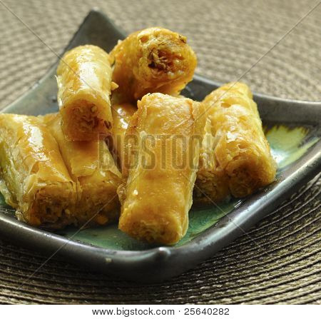 The baklava, an arabic dessert made of thin pastry, nuts.