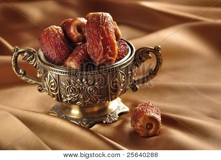 A vintage bowl of dates