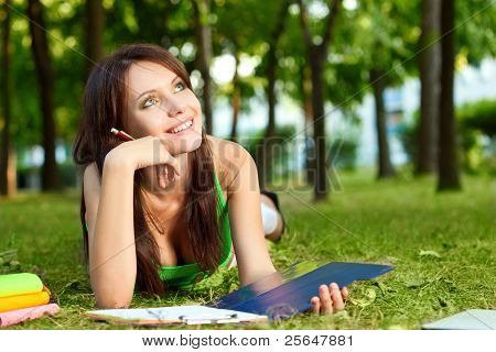 woman laying on grass and dreaming