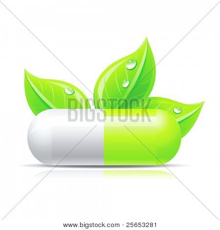 Green pill isolated on white with leafs and droops.