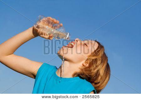 Thirsty Child Drinking Water