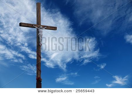 Wooden cross on a background sky.