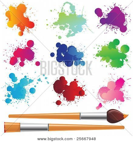 color splashes and paintbrushes over white background
