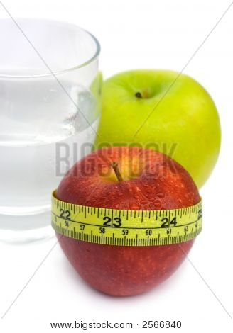 Glass With Water, Green And Red Apple