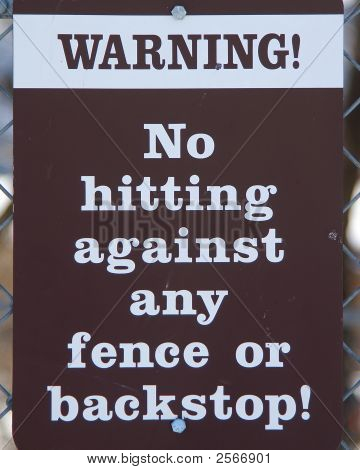 Street Signs Do Not Hit Fence