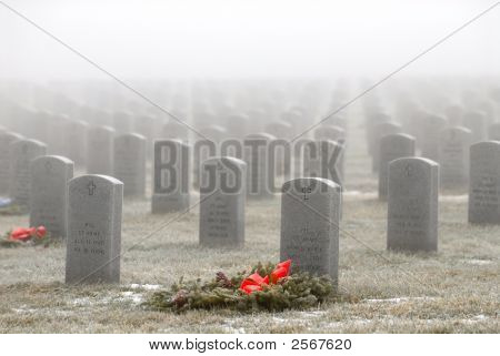 Headstones In A Military Cemetery On A Foggy Day