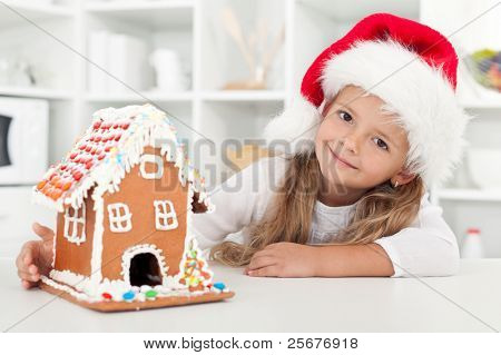 My christmas gingerbread cookie house - little girl in the kitchen at holidays