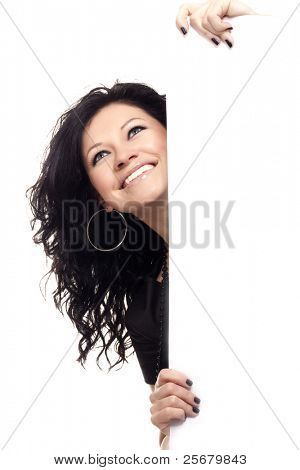 beautiful girl peeping over a wall isolated over a white background