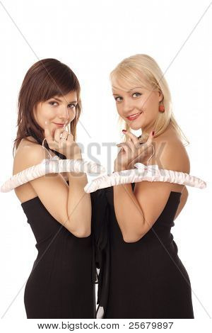 Two girls with pink hangers over white