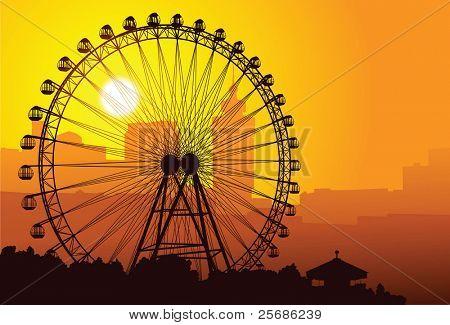 Silhouette von einem Riesenrad bei Sonnenuntergang