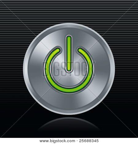 Round metal start button with green light on dark background
