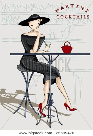Beautiful stylish woman sitting at a cocktail bar