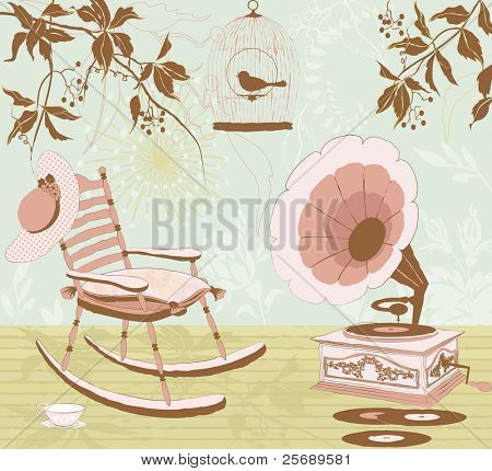 Rocking-chair, the gramophone and the cage with a bird on the veranda of the house - retro style