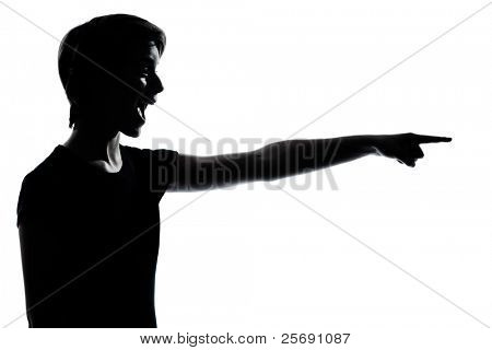 one caucasian young teenager silhouette boy or girl pointing laughing  portrait in studio cut out isolated on white background
