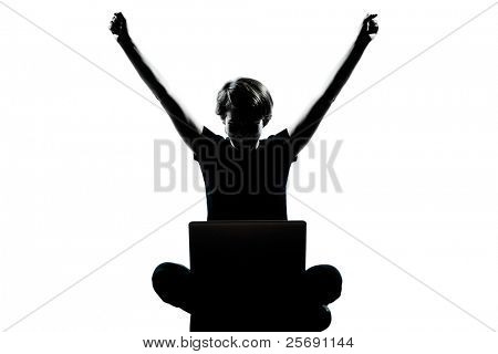 one caucasian young teenager silhouette boy  girl computer computing laptop happy success full length in studio cut out isolated on white background