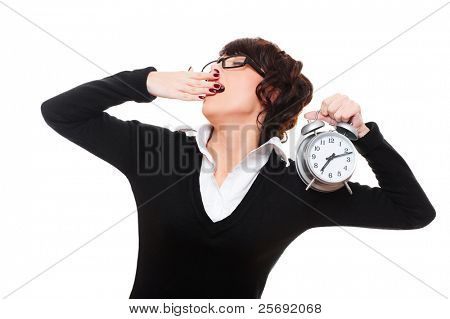 drowsy businesswoman holding alarm clock and yawning. isolated on white background