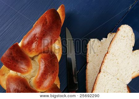 baked product : cut of challah over blue painted wooden board