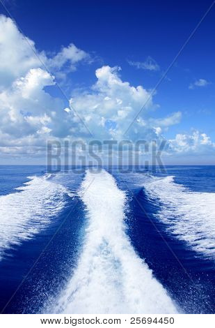 Boat wake prop wash on blue ocean sea in sunny day