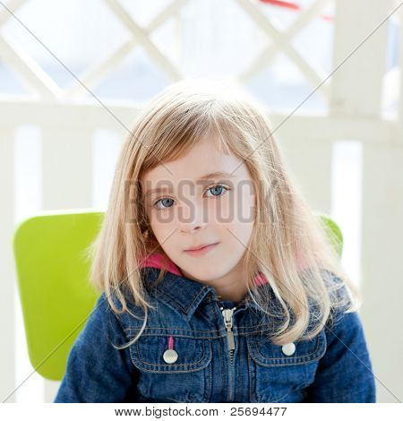 blue eyes kid girl portrait outdoor sit in green chair