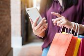 Consumerism, Shopping, Lifestyle Concept, Young Woman Holding Colorful Shopping Bags And Smartphone  poster