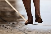 Man Legs Walk Along A Tight Line In The Beach,balances On The Slackline Close Up poster