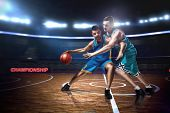 Two Basketball Players During Scrimmage On Indoor Basketball Court poster