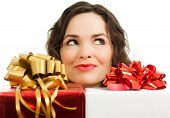Beautiful Woman Peeking Over Presents