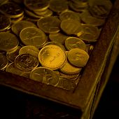 stock photo of dirham  - A heap of UAE Dirham coins in a trunk - JPG