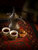 stock photo of nomads  - Arabic coffee and dates set up - JPG