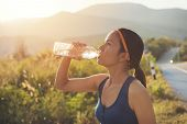 Sport Woman Drinking Water During Morning Jogging, Side View Of Beautiful Girl In Sport Clothes Drin poster