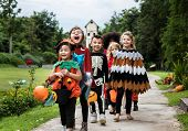 Young kids trick or treating during Halloween poster