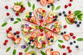 Watermelon Pizza With Various Fresh Fruits With The Addition Of Cream Cheese, Mint And Edible Flower poster
