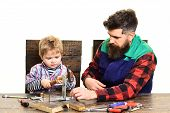 Family Concept. Father&son In Workshop. Boy Learning Clogs Nail. Dad&son Working With Tools. Parent  poster