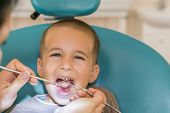Pediatric Dentist Examining A Little Boys Teeth In The Dentists Chair At The Dental Clinic. Dentist  poster
