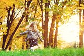 Happy Child Girl Running In Autumn Park. Little Girl Having Fun In Autumn. Happy Childhood. Stylish poster