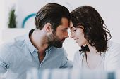 Young Happy Romantic Couple Together At Home. Handsome Bearded Man And Beautiful Smiling Woman Tochi poster