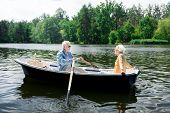 Stylish Appealing Elderly Wife Feeling Amazing Sitting In Boat With Husband poster