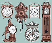 stock photo of wind up clock  - A set of elegant antique clocks - JPG