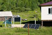 The Weather Station Building Is Weather Forecasters, Powered By Solar Panels. Solar Panels On A Weat poster