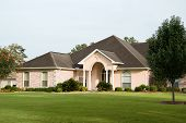 picture of nice house  - nice brick home on green sweeping lawn - JPG