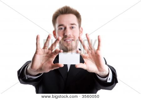 Caucasian Businessman And Business Card