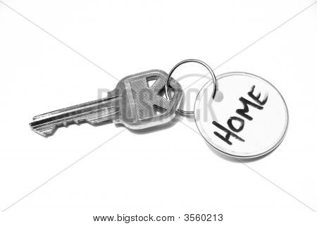 House Key With Label On White Background
