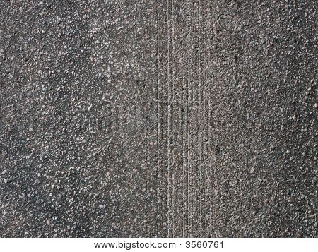 Snowtire Marks On Asphalt