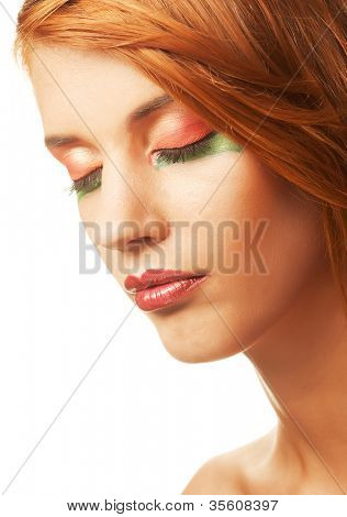 Happy smiling redhaired woman with creative makeup