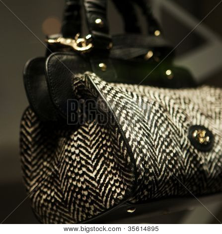 Close-up photo of a handbag exposed in a shop-window