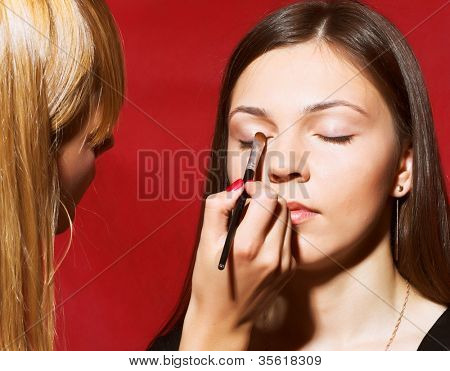 beautiful brunette girl model, while make-up before shooting session