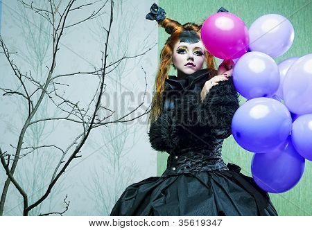 Princess with balloons. Make up in doll style.