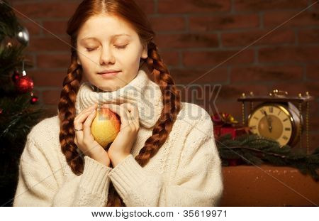 redhair christmas woman wit apple. Home interior.