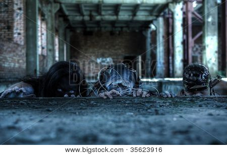 group of people with agressive face-art. zombie style. shot in destroyed building