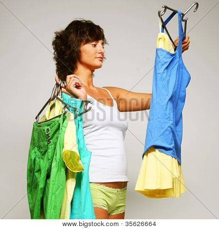 happy young woman choose clothes. happy shopping.